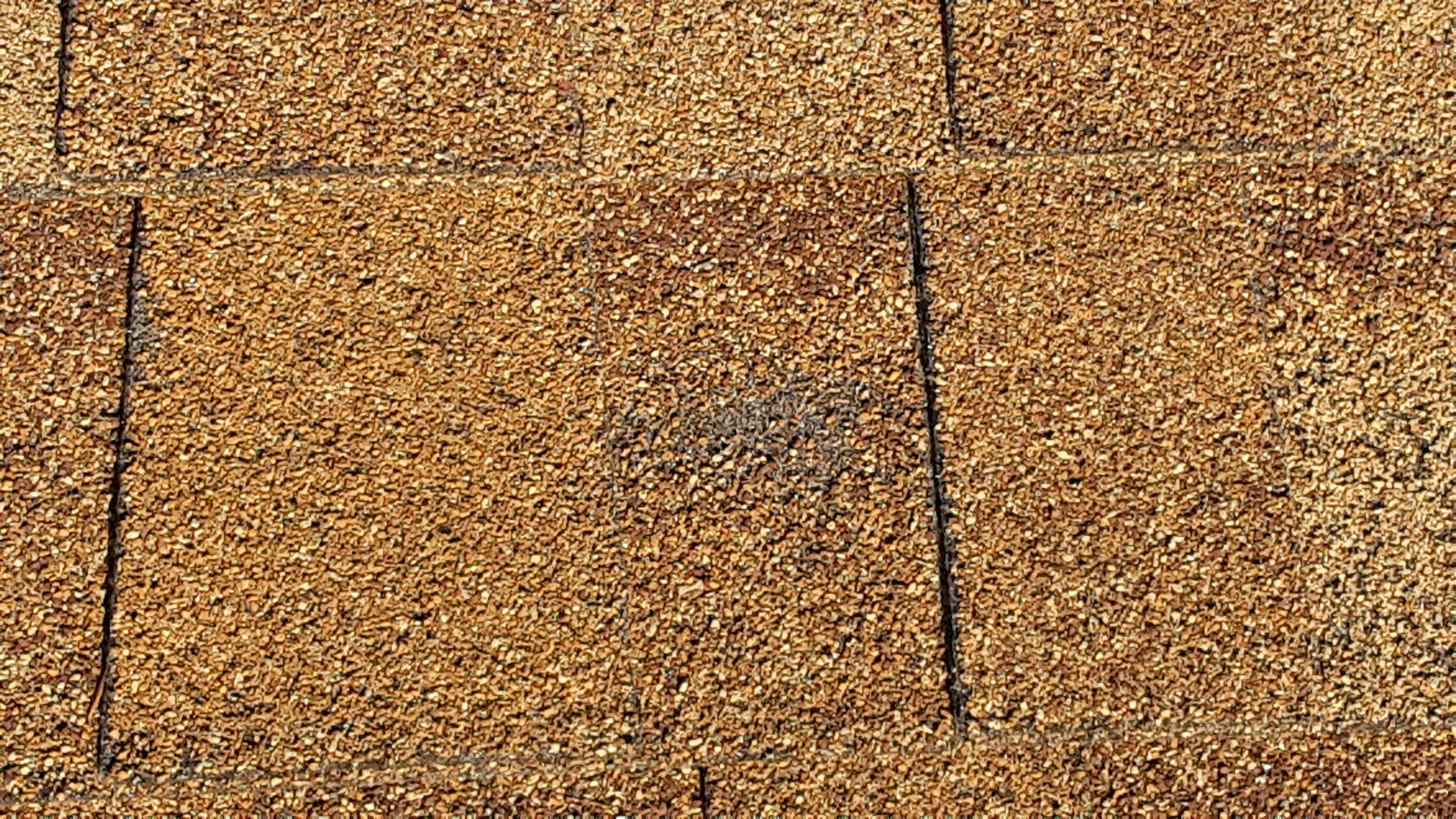Hail damage on a residential roof