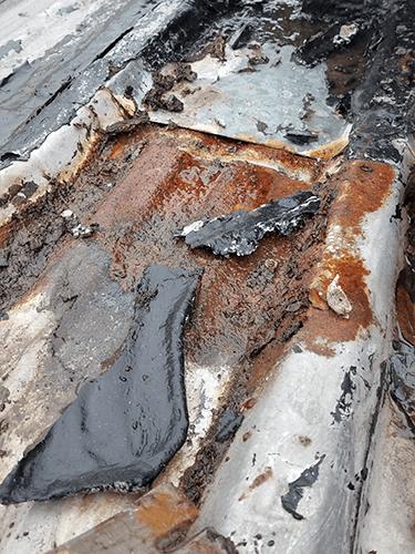 Rusted Metal-used tar to seal seams